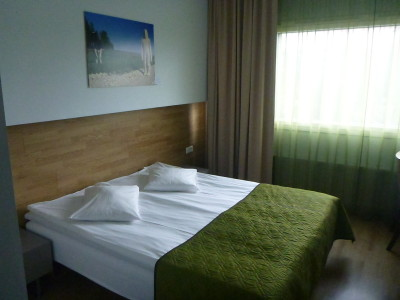 My comfortable bedroom at Hotel Shnelli.