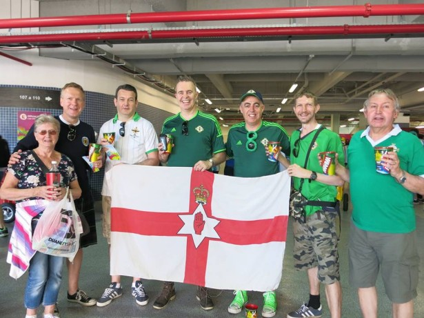A Northern Ireland shirt, a beer, my flag, my Dad and some great lads - this is me.