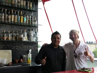 With the barman on the top floor bar