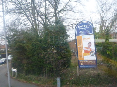 Driving past Sutton Cricket Club and Sutton United FC