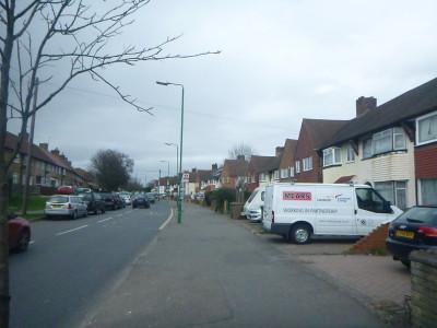 Walking on Green Wrythe Lane in Carshalton, England about to cross the border into Wrythe, Austenasia