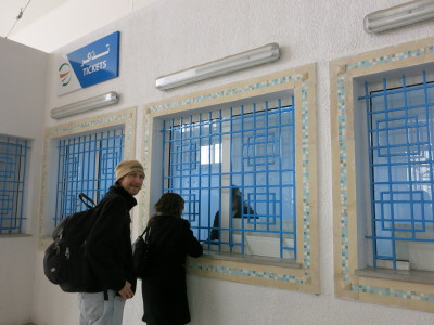 Buying a ticket for the train to Sidi Bou Said.