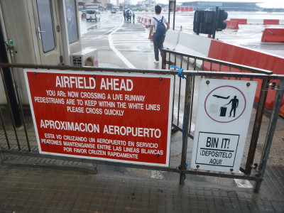 A warning sign in front of the runway