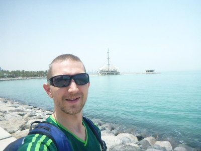 Walking along the seafront in Salmiya