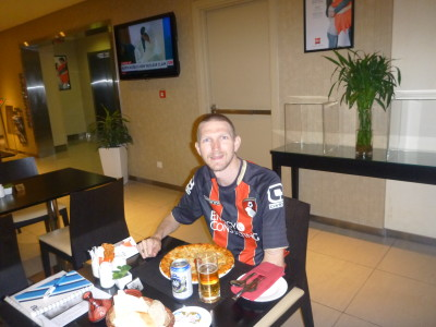 Eating at the restaurant in the Hotel Ibis Sharq - pizza and non alcoholic beer.