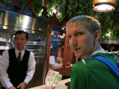 Ordering a beer in the Brewery Bar at the Yanggakdo Hotel in Pyongyang.