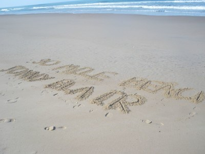 I signed my name on sand at the start of 90 mile beach
