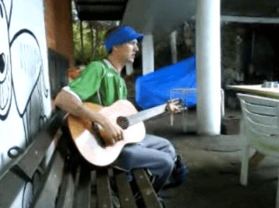 Playing guitar while backpacking in Tasmania
