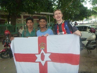 Posing with some locals with my Northern Ireland flag.