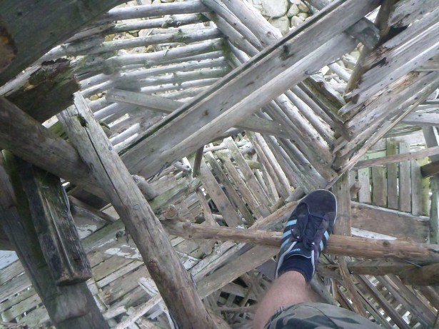 Climbing up a driftwood structure in Nimis