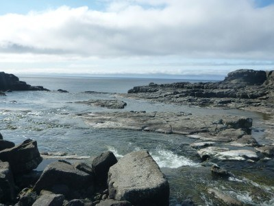 The rocks where the waterfall flows into the sea.