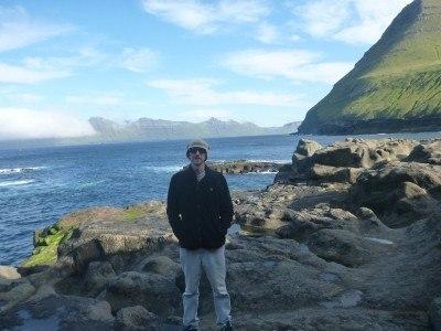 By the waves at the coast in Gjogv, Eysturoy, Faroe Islands