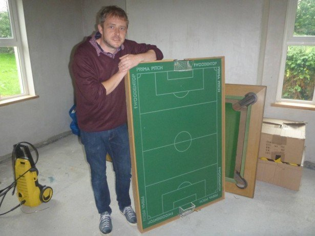 Mr. Stewart with his Subbuteo pitch - it's the national sport in Podjistan
