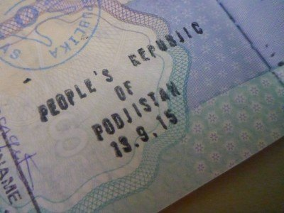Passport stamped on arrival in the People's Republic of Podjistan