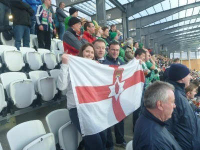 With the travelling Northern Ireland flag (fleg)