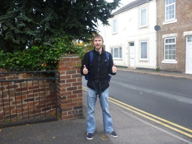 Crossing the border on foot, my left foot here is in England/UK and my right foot is in Adammia