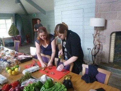 Helen and Chloe preparing the meal