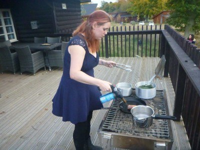 Helen cooking the partridge