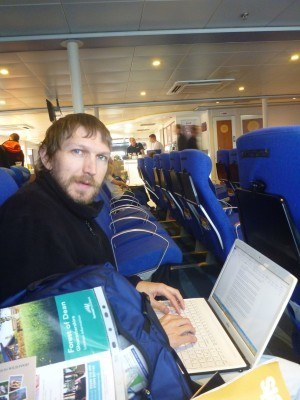 Working on my laptop on route to Guernsey