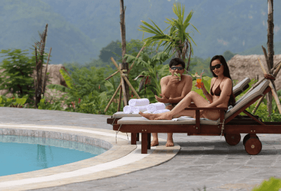 Relaxing by the Swimming Pool at Mai Chau Ecolodge