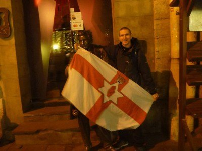 Leopold poses with the Northern Ireland flag