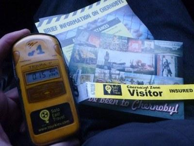 Geiger counter, wristband, info sheet, postcard.