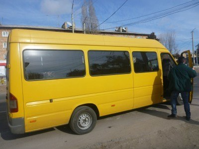 Our yellow bus arrives in Cholpon Ata