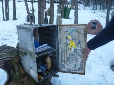 The visitors box with tributes and items that have been left, plus the log book.