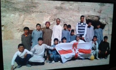 Jonny Blair flying the fleg with the kids of Habaik Town in Afghanistan, 2016