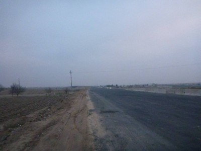 Staring back to the wilderness of Uzbekistan from the border