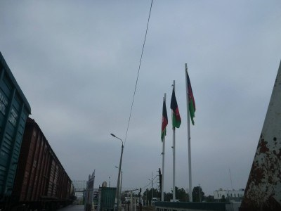 A hat-trick of Afghanistan flags on my right