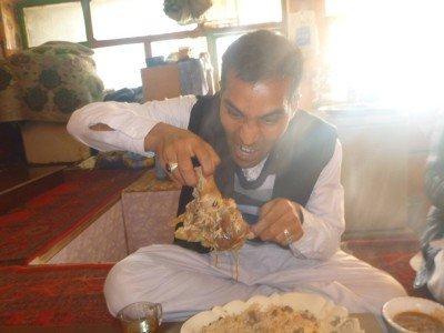 Reza gets stuck into his food!