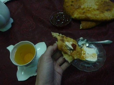 Cheese, jam, bread and tea for breakfast