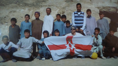 Posing with the Afghan children I played football with in Samangan, Afghanistan