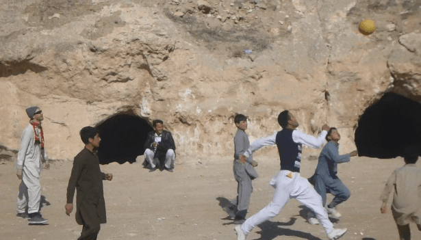 Reza in action playing football in Samangan, Afghanistan