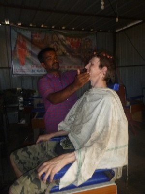 Getting my beard chopped off in Hampi, India