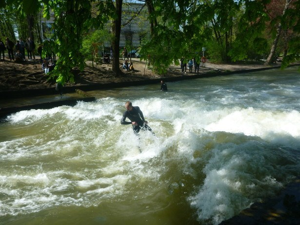 Locals surfing at the Eisbach