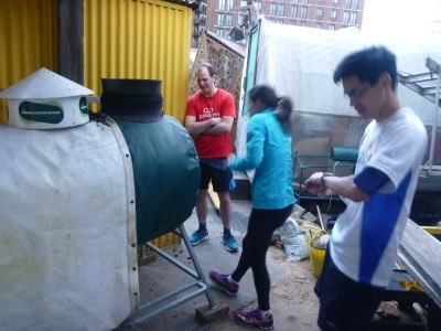 Churning compost at the Skip Garden