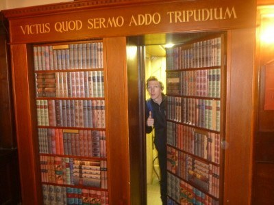 Me at the Hidden Bookcase in the Somerstown Coffee House