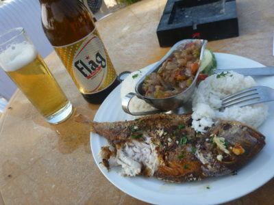 Barbecued fish and beer at N'Gor beach