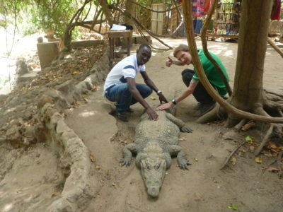 Moses Bajo and I, stroking the crocodile!