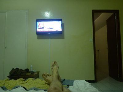 Watching TV at Hotel Baraka in Dowtown Dakar, Senegal