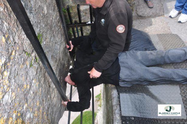 Kissing the Blarney Stone in County Cork, Republic of Ireland