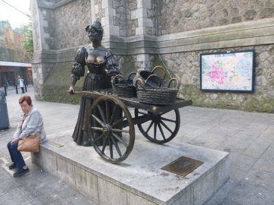 As she wheeled her wheelbarrow through streets broad and narrow