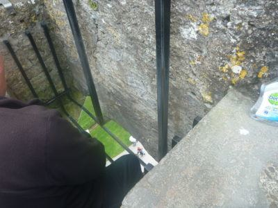 The person in front kissing the Blarney Stone