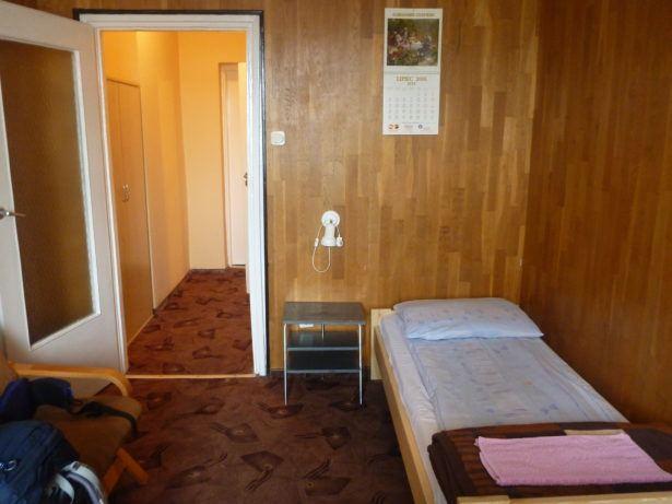 My bedroom at Noclegi Rekord Hotel on an island in Starogard Gdański, Poland.
