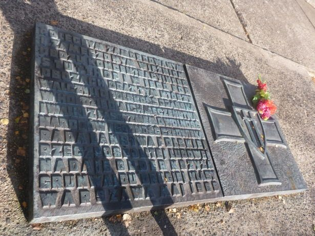 Tribute by the mass graves