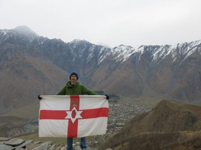 Flying the Northern Ireland flag on the Gergeti Hike