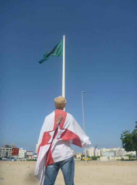 "Northern Irish nationalist posing at Saudi Arabia's ""World's Highest Flagpole""."