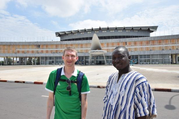 Jeremies and I in front of the Togo Parliament in Lome.